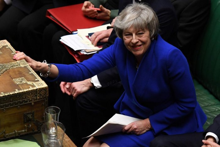 A handout photograph released by the UK Parliament's shows Britain's Prime Minister Theresa May (C) as she reacts during a debate on a no-confidence motion in the House of Commons in central London on January 16, 2019. AFP photo