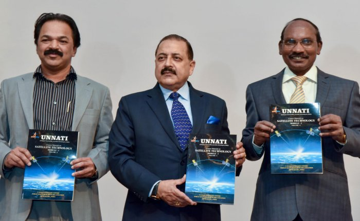 Dr Jitendra Singh, Union Minister of State, Department of Space (centre), releases the course book during the inauguration of Unnati training programme in Bengaluru on Thursday. P Kunhi Krishnan, Director, URSC and K Sivan, chairman, Isro, are also seen.