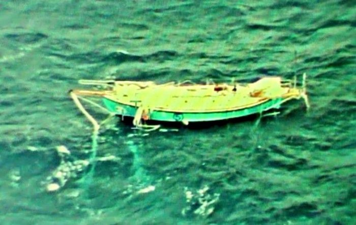 The capsized yacht Thuriya of solo sailor Abhilash Tomy is pictured at sea in this September 24, 2018 handout photo by the Indian Navy. Indian Navy/Handout via REUTERS ATTENTION EDITORS - THIS PICTURE WAS PROVIDED BY A THIRD PARTY. NO RESALES. NO ARCHIVE.