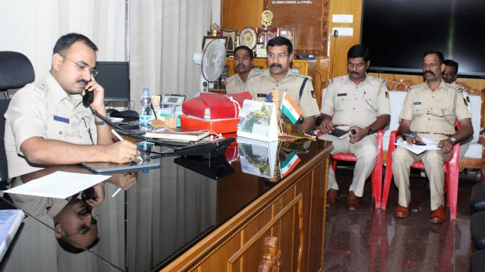 Udupi Superintendent of Police Laxman Nimbargi receives a call during the phone-in programme in Udupi.