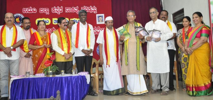 Taluk Kannada Sahitya Sammelana immediate past president Upendra Somayaji releases books 'Bogaseyalli Sagara' and 'Tuluvara Nadu-Nudi' at Taluk Kannada Sahitya Sammelana in Udupi on Friday.