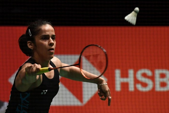 BOWS OUT: Saina Nehwal of India returns during her straight-game defeat to Carolina Marin in the semifinals of the Malaysia Masters badminton tournament in Kuala Lumpur on Saturday. AFP