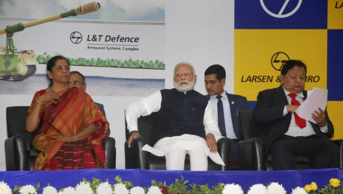 Prime Minister Narendra Modi, Defence Minister Nirmala Sitharaman and L & T CEO AM Naik during the dedication of L&T's Armoured System Complex to the nation in Hajira, Saturday, Jan. 19, 2019. (PTI Photo)