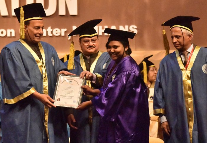 Union Minister for Home Affairs Rajnath Singh confers a degree on Neethi Prem during the 23rd Convocation of National Institute of Mental Health and Neuro Sciences (Nimhans) in Bengaluru on Saturday. Union Minister for Health and Family Welfare J P Nadda