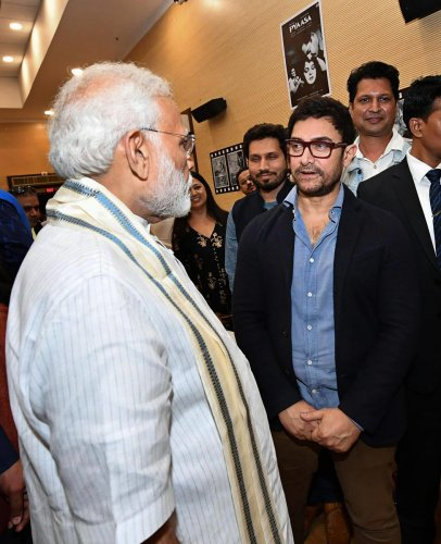 PM Narendra Modi interacts with actor Aamir Khan during the inauguration of the National Museum of Indian Cinema in Mumbai. PTI