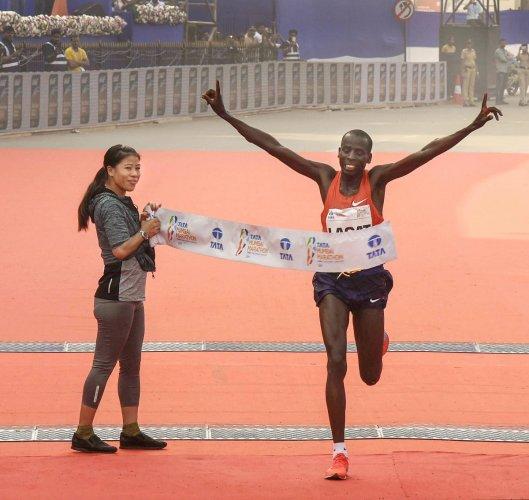 Cosmas Lagat of Kenya wins the Mumbai Marathon on Sunday. Boxer Mary Kom is at left. PTI