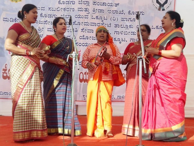 Participants take part in the folk song competition at Yuvajana Mela in Galibeedu village in Madikeri.