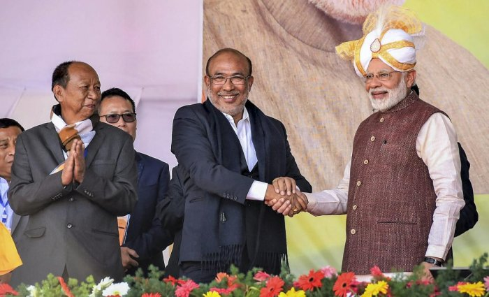 Prime Minister Narendra Modi shakes hands with Manipur Chief Minister N Biren Singh during the launch of development projects, in Imphal, Friday, Jan 4, 2019. (PTI Photo)