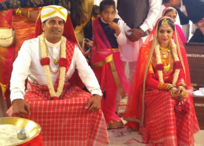NEW INNINGS Former Karnataka pacer N C Aiyappa and actor Anu Poovamma during their wedding at the Kodava Samaja in Virajpet on Sunday.