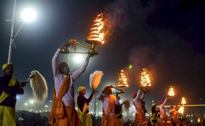 Priest perform Ganga Aarti on the eve of Paush Purnima festival during ongoing Kumbh Mela 2019 in Allahabad, Jan 20, 2019. (PTI Photo)