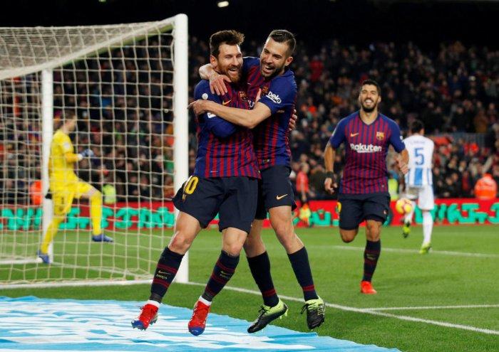 La Liga Santander - FC Barcelona v Leganes - Camp Nou, Barcelona, Spain - January 20, 2019 Barcelona's Lionel Messi celebrates scoring their third goal with Jordi Alba. REUTERS