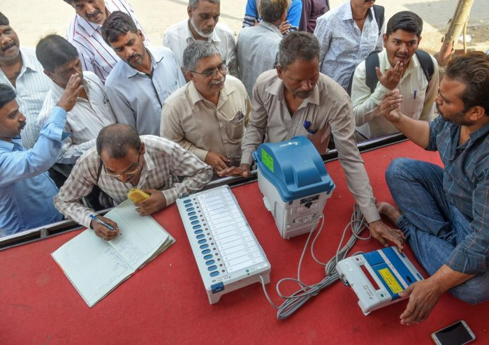 Indians try out the Electronic Voting Machine (EVM) in conjunction with the Voter-Verified Paper Audit Trail (VVPAT), a ballotless voting system, at an Election Commission demonstration stand in Mumbai on January 16, 2019. - These demonstrations are an ef