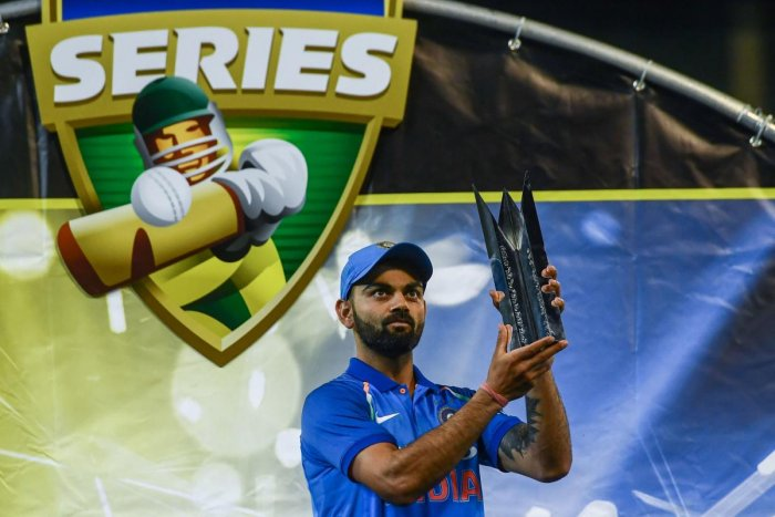 India's captain Virat Kohli holds up the team's one-day international series trophy after defeating Australia at the Melbourne Cricket Ground in Melbourne. AFP File photo