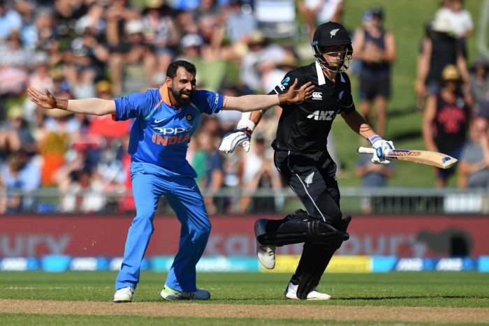 Mohammed Shami (L) appeals for a leg-before-wicket (LBW) call on New Zealand's Mitchell Santner (R) during the first one-day international (ODI) cricket match between New Zealand and India at McLean Park in Napier. AFP Photo
