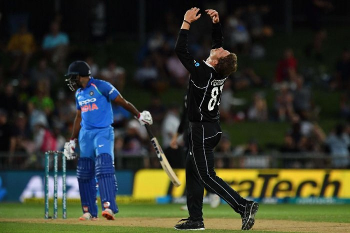 New Zealand's Lockie Ferguson (R) reacts to a dropped catch off the batting India's Ambati Rayudu (L) during the first one-day international (ODI) cricket match between New Zealand and India at McLean Park in Napier. AFP photo