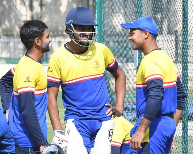 WHO'S IN, WHO'S OUT? Karnataka's opening batsmen R Samarth, D Nischal and Mayank Agarwal share a light moment during a practice session in Bengaluru on Wednesday. DH Photo/ Srikanta Sharma R