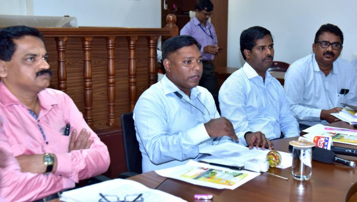 Deputy Commissioner Sasikanth Senthil addresses a press meet in Mangaluru on Wednesday.