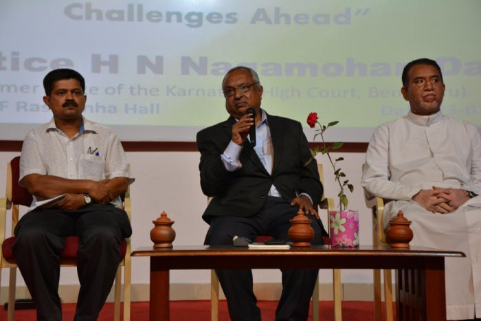 Former Karnataka High Court judge Justice H N Nagamohan Das speaksto students during an interactive session organised as a part of the Constitution Week at L F Rasquinha Hall in St Aloysius College on Wednesday.