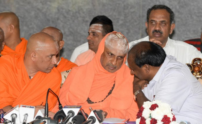 hief Minister H D Kumaraswamy speaks to Suttur Mutt seer Shivaratri Deshikendra Swami and Adichunchanagiri Mutt seer Nirmalanandanatha Swami during a meeting convened to dicuss preparations to be made for the Kumbh Mela to be held in T Narasipura, in Beng
