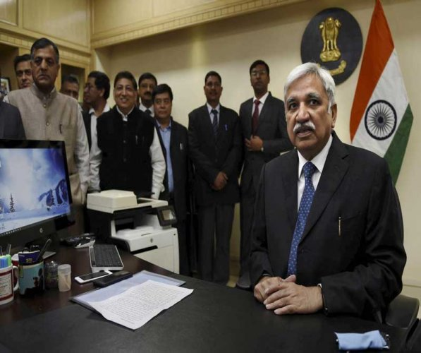"""We are not going back to the era of ballot papers and we are not going back to that era where we have ballot papers being lifted (and) muscle-men being employed, besides the delay in the counting and also too much harassment of the polling staff on the ground,"" Chief Election Commissioner, Sunil Arora, said. (PTI File Photo)"