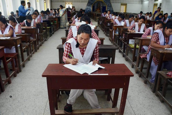 School girls appear in a TBSE's intermediate exams at an examination center in Agartala. PTI