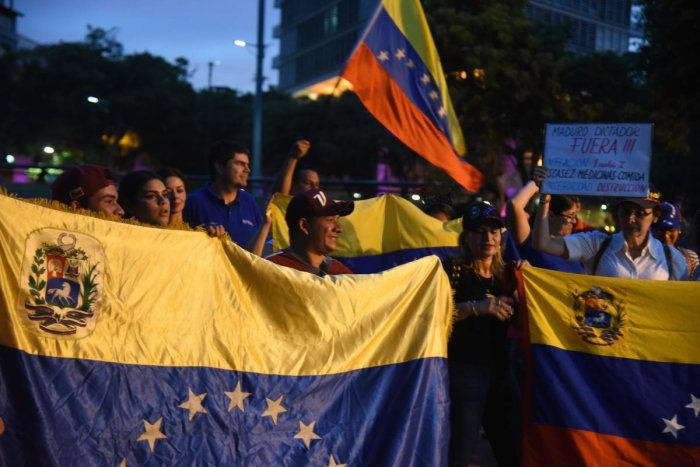 Venezuelans opposed to President Nicolas Maduro hold a demonstration in Asuncion, Paraguay in support of opposition leader Juan Guaido's self-proclamation as acting president of Venezuela. AFP.
