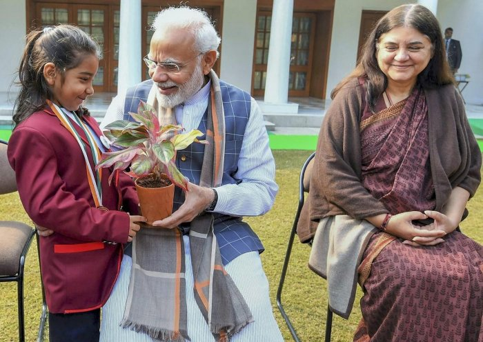 Prime Minister Narendra Modi felicitates a brave girl during his interaction with the winners of Rashtriya Bal Puraskar. Union Minister for Women and Child Development Maneka Sanjay Gandhi is also seen. PTI photo