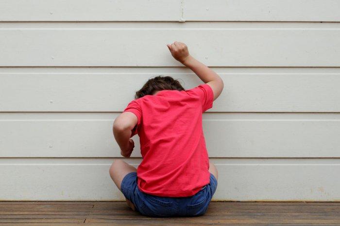 Child throwing a tantrum.