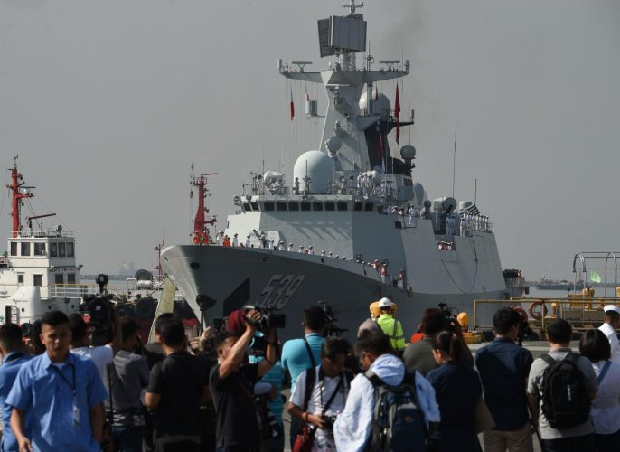 Journalists wait for the arrival of Chinese guided-missile frigate Wuhu at the international port in Manila on January 17, 2019. AFP
