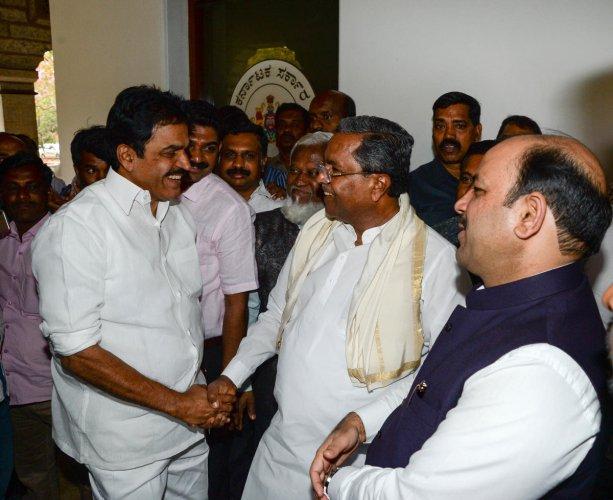 Seat talks: (From left) AICC general secretary in charge of Karnataka K C Venugopal, coordination panel chairman Siddaramaiah and JD(S) secretary-general Danish Ali after a meeting in Bengaluru on Thursday. DH Photo/Satish Badiger
