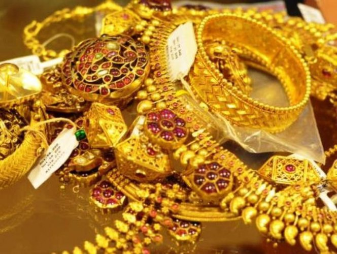 Overcoming a mixed sentiment from global markets, gold prices climbed on account of favourable domestic cues like wedding season demand from local jewellers as well as retailers.
