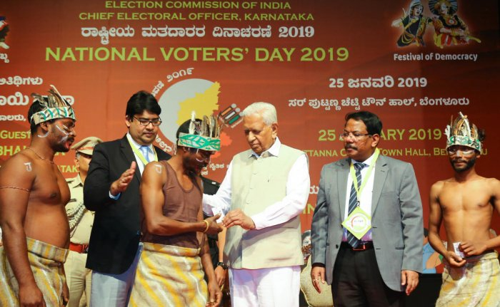Governor Vajubhai Vala distributed the Electoral Photo Identity Cards (EPIC) to the newly enrolled voters on the occasion of National Voters Day Celebration program at Town Hall, organised by Election Commission of India, in Bengaluru on Friday.