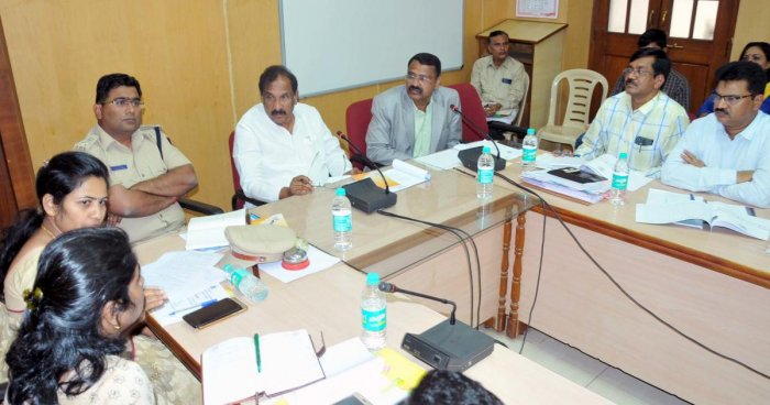 District In-charge Minister K J George chairs a meeting on drought management in Chikkamagaluru on Friday. Deputy Commissioner M K Srirangaiah, Zilla Panchayat CEO C Sathyabhama, SP Harish Pande and others look on.