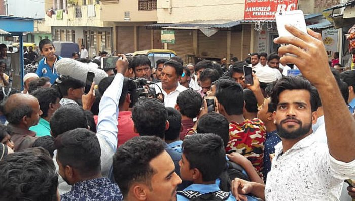 Crowd puller: Multilingual actor Prakash Raj interacts with the residents of Shivajinagar on Friday.