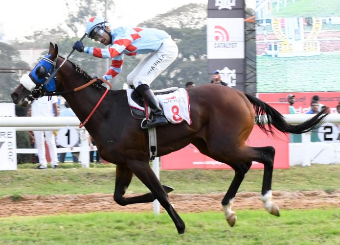 BRILLIANT: Jockey P Trevor guides The Invader to victory in the Catalyst Properties Bangalore Derby at the Bangalore Turf Club in Bengaluru on Saturday. DH PHOTO/BH SHIVAKUMAR