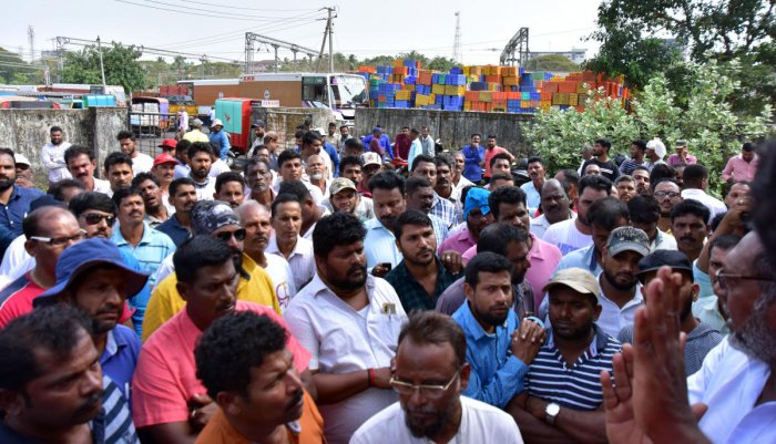 Fishermen stage a protest against the use of lights while fishing in front of the Fisheries Department deputy director's office at Bunder in Mangaluru.