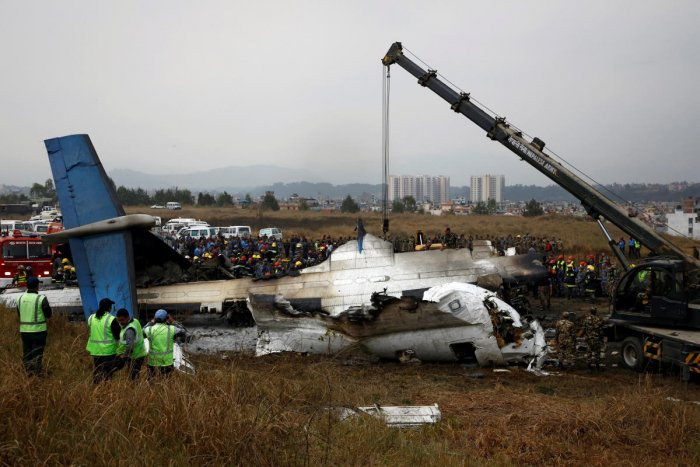 Rescue workers work at the wreckage of a US-Bangla airplane after it crashed at the Tribhuvan International Airport in Kathmandu. (Reuters File Photo)