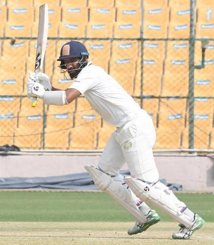 Saurarshtra's Cheteshwar Pujara en route on his unbeaten 108 against Karnataka at the M Chinnaswamy Stadium in Bengaluru on Sunday. DH Photo/ Srikanta Sharma R