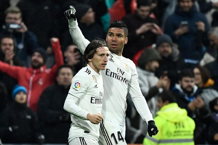 Real Madrid's midfielder Casemiro (right) celebrates with Luka Modric after scoring against Sevilla on Saturday. AFP