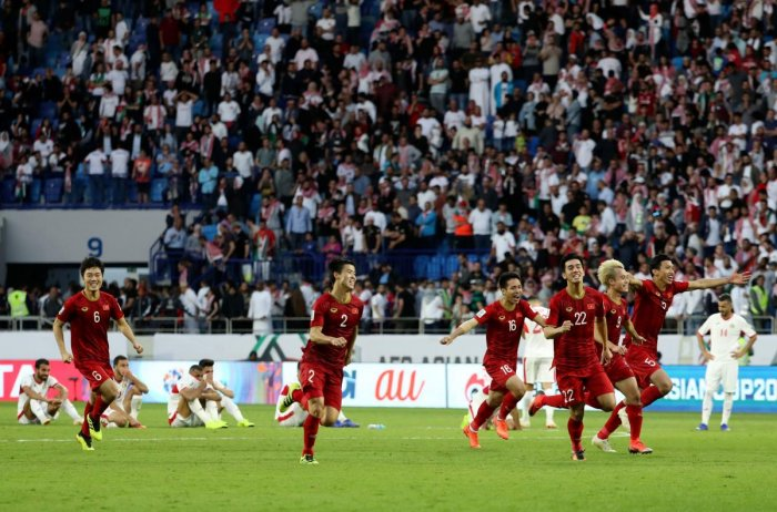 ECSTATIC: Vietnam players celebrate their round-of-16 win over Jordan on Sunday. AFP