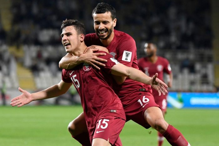 Qatar's Bassam Al Rawi (left) celebrates his goal during the AFC Asian Cup match against Iraq in Abu Dhabi on Tuesday.