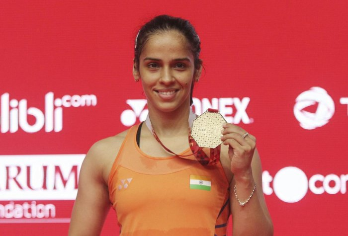Saina Nehwal with the gold medal after winning the Indonesian Masters on Sunday. AP/ PTI