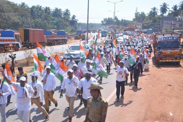 Congress workers take out a padayatra from Talapady to Pumpwell on Monday.