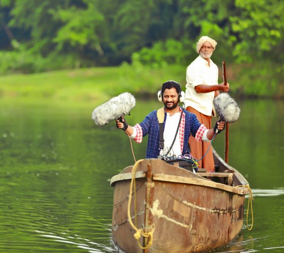 Resul Pookutty captures the sounds of a river using a set of mics.