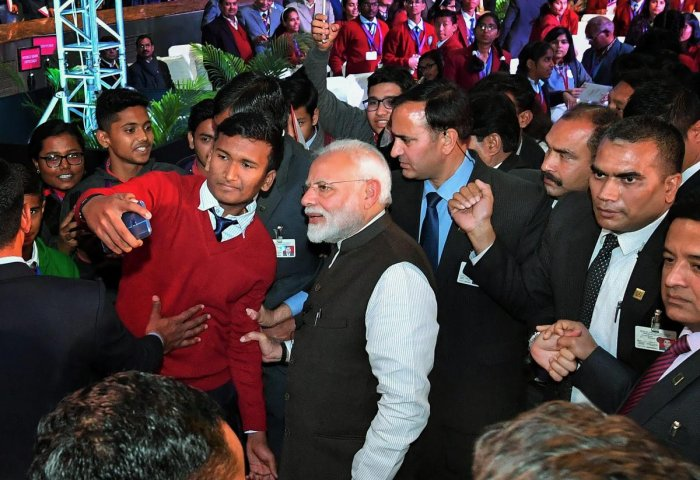 Prime Minister Narendra Modi poses for a selfie with a student at an interactive session 'Pariksha Pe Charcha 2.0', in New Delhi on Tuesday.PTI