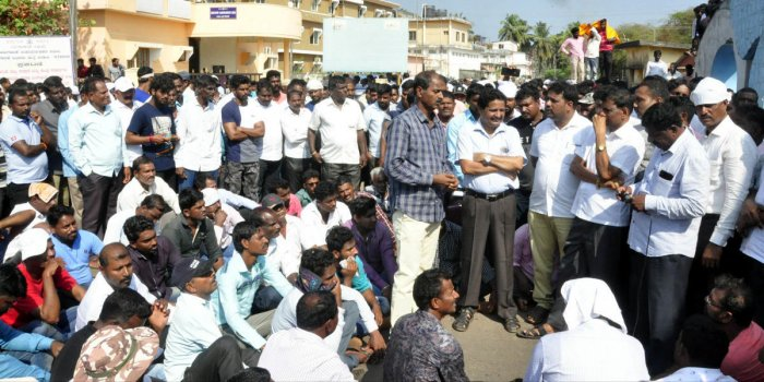 Udupi fishermen stage a protest at Malpe port on Tuesday.