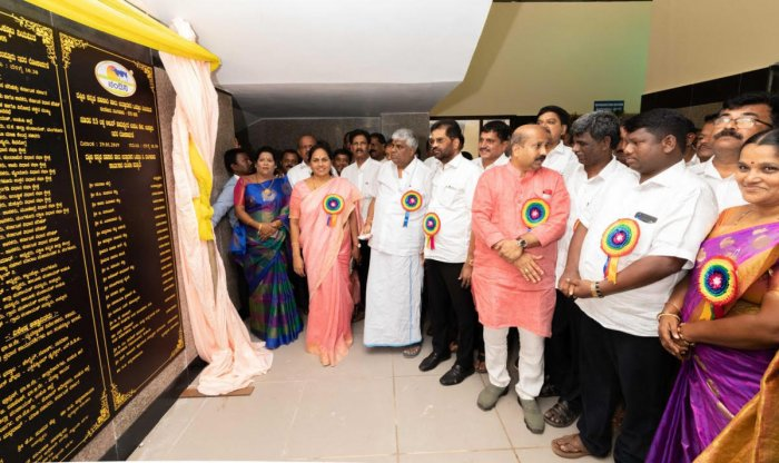 PWD Minister H D Revanna and others at the inauguration of DKMUL dairy at Uppooru.