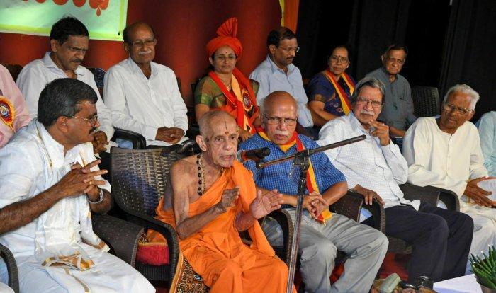 Udupi Pejawar Mutt seer Vishwesha Theertha Swami speaks on the occasion of 23rd Zilla Kannada Sahitya Sammelana at Town Hall in Mangaluru on Tuesday.