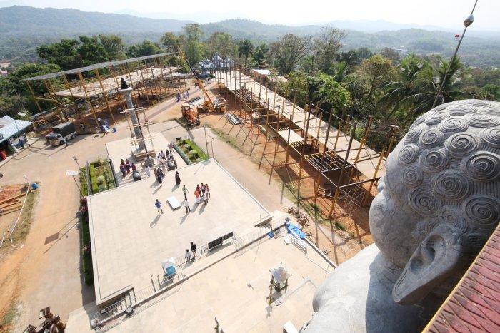 The work on scaffolding is in progress for the Mahamastakabhisheka of the Bahubali statue at Rathnagiri in Dharmasthala.
