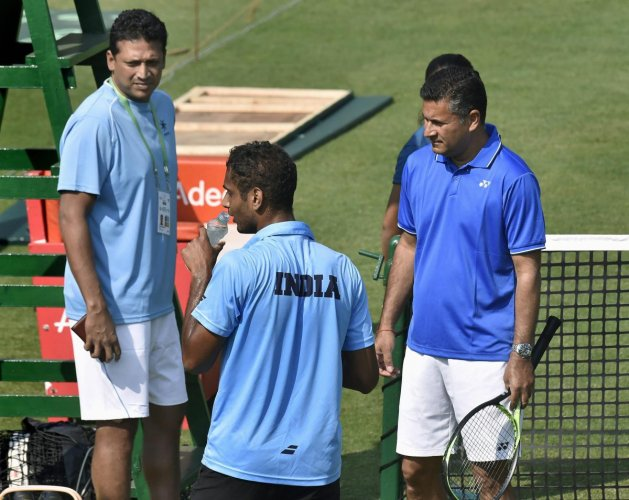 India's non-playing captain Mahesh Bhupathi with coach Jishan Ali and player Ramkumar Ramanathan during a training session ahead of Davis Cup match against Italy in Kolkata. PTI photo